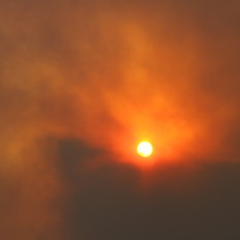 Sun being choked out by forest fires in Washington state.