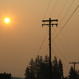 Morning looks like dusk in forest fire smoked out Medford, Oregon.