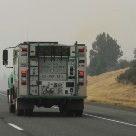 In Oregon, USDA and fire trucks from as far as San Diego, trying to do something about the forest fires, which reduced visibility to where even the hill to the right of the highway could not even be seen.