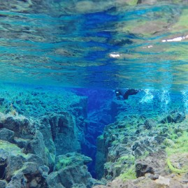 Iceland - Snorkleing in Silfra, where the North American and European tectonic plates are separating by 2cm every year.